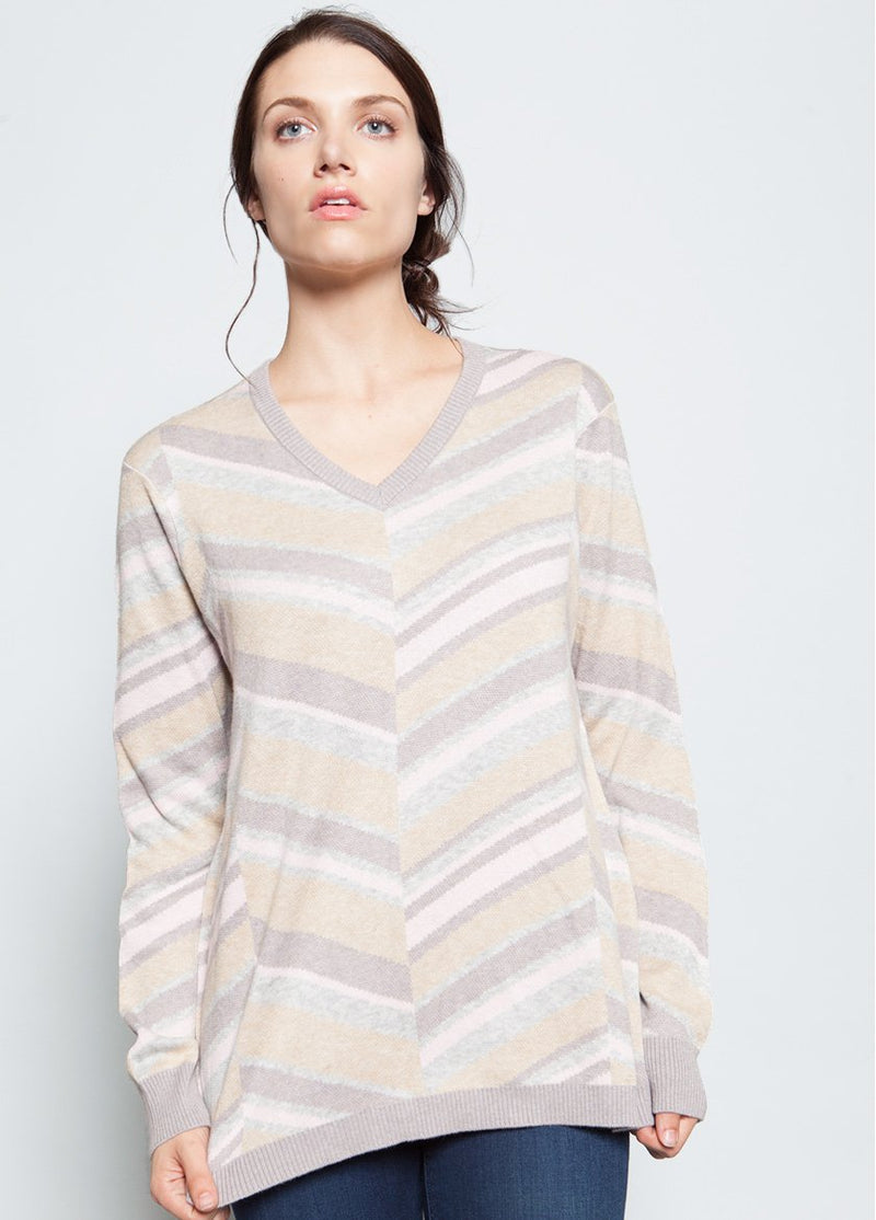 CREME STRIPED SWEATER IN A V STYLE TO THE FRONT CENTER ON A FEMALE MODEL