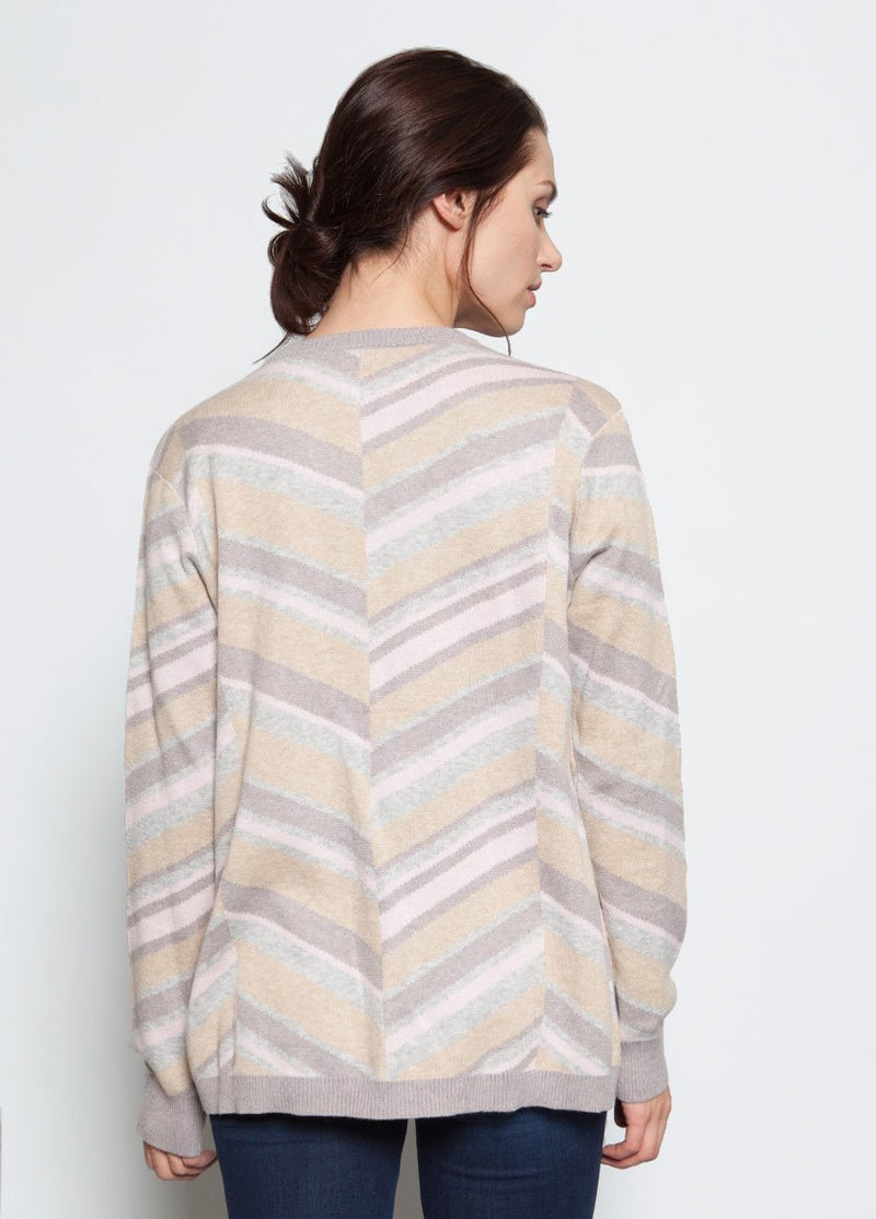 CREME STRIPED SWEATER IN A V STYLE TO THE  CENTER BACK VIEW ON FEMALE MODEL