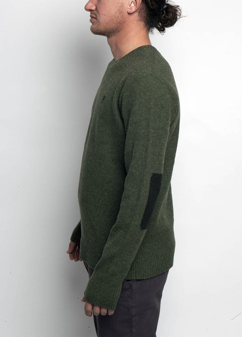 MAN IN KNIT GREEEN SWEATER WITH CONTRASTING ELBOW DETAIL  SIDE VIEW