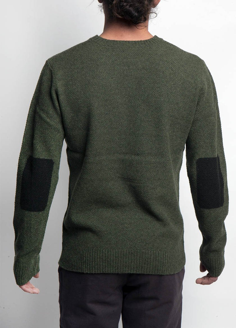 MAN IN GREY KNIT SWEATER BACK VIEW SHOWING CONTRASTING ELBOW PATCHES