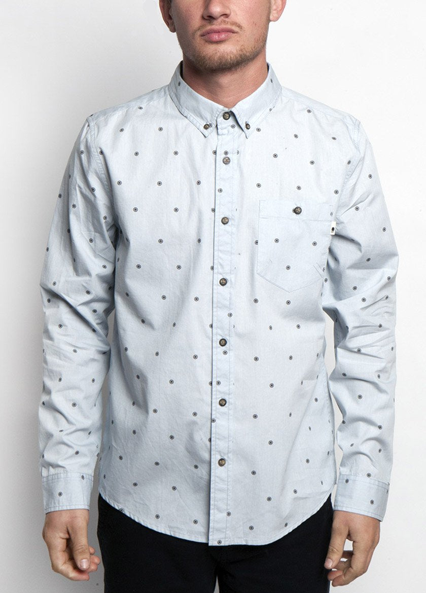 Man is dress shirt, pearl blue color, with dot design. Front view.
