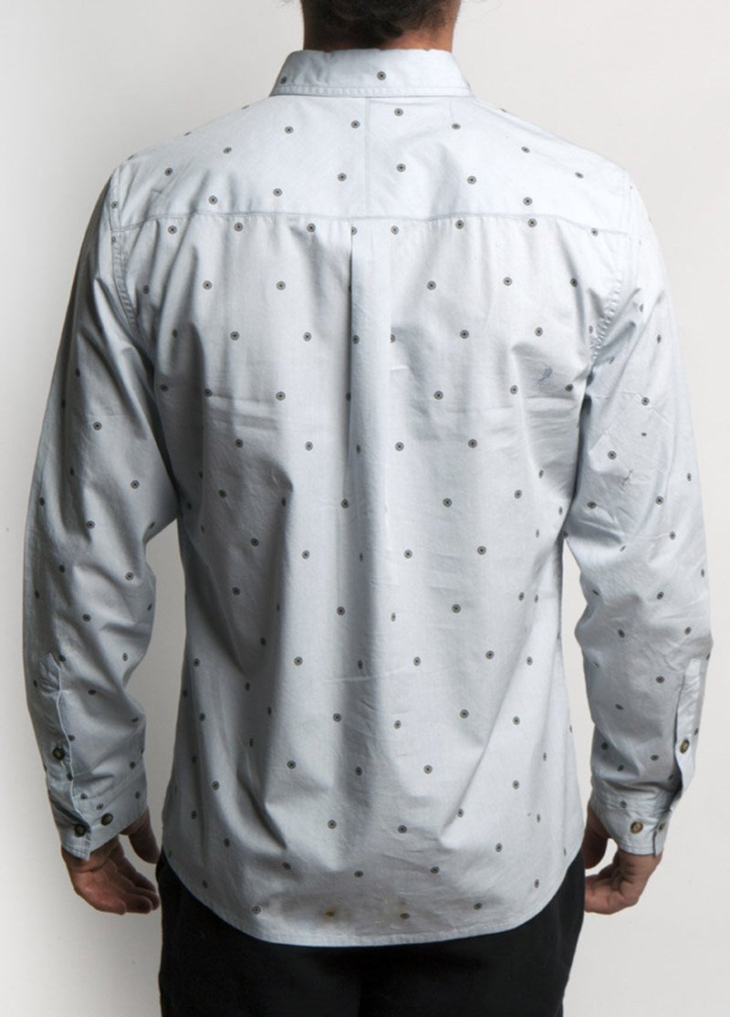 Man is dress shirt, pearl blue color, with dot design.  Back View