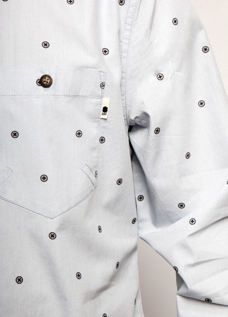 Man is dress shirt, pearl blue color, with dot design. Detail of front