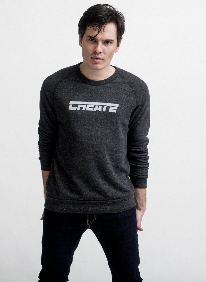 man wears eco black create fleece crew neck