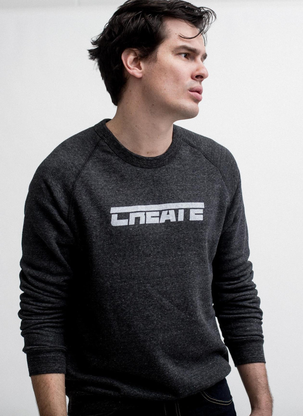 man looks to the side in create fleece sweatshirt