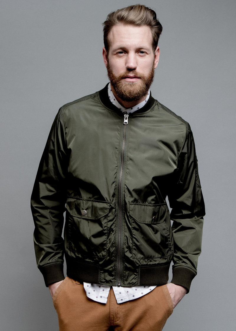 NYLON BOMBER JACKET IN GREEN ON MALE MODEL FRONT VIEW