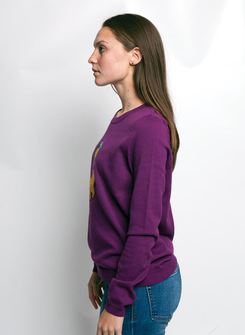 SIDE VIEW OF PURPLE SWEATER WITH A COLORFUL PUG DOG ON WOMEN