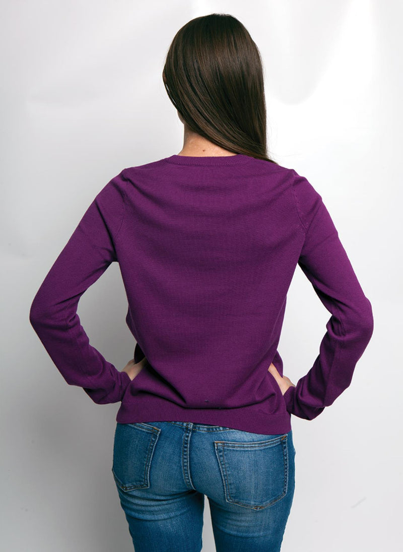 BACK VIEW OF PURPLE SWEATER WITH A COLORFUL PUG DOG, ON WOMEN MODEL ARMS TO SIDES