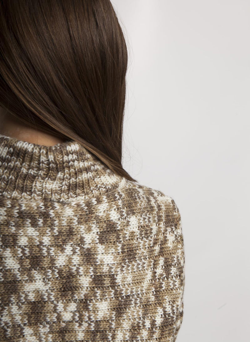 DETAIL ON BACK OF ELLA MOCK SWEATER IN MUSHROOM COLOR ON FEMALE MODEL