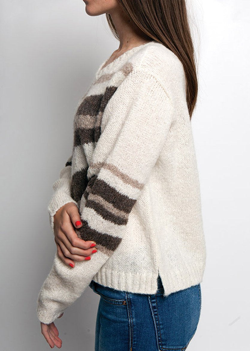 SIDE VIEW OF IVORY TONED ALPACA SWEATER WITH VNECK AND DIAGNOL STRIPES IN BROWN TONES SHOWING ARM DETAILS