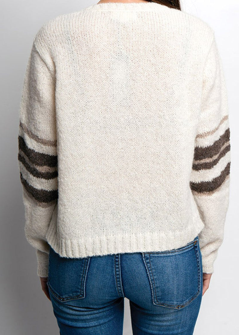 BACK VIEW OF IVORY ALPACA SWEATER ON FEMALE MODEL ARMS TO THE SIDE.