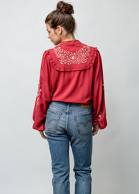Woman wearing Anya Blouse in Red Back Image Full Body