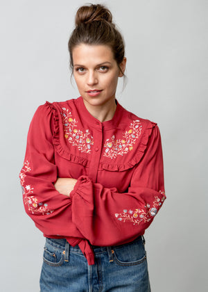 Woman wearing Anya Blouse in Red Frontal Image