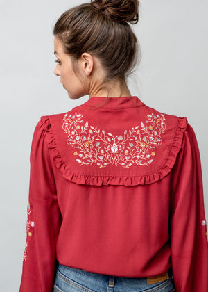 Woman wearing Anya Blouse in Red Back Image