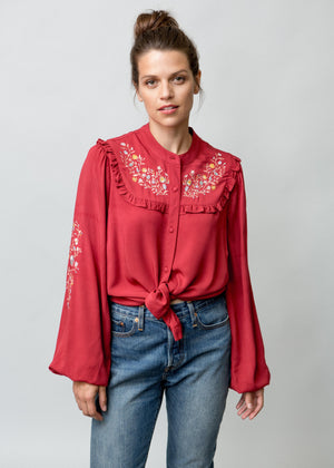 Woman wearing Anya Blouse in Red Frontal Image Half Body