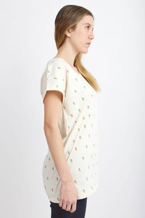 Side view of woman wearing vintage white shirt.