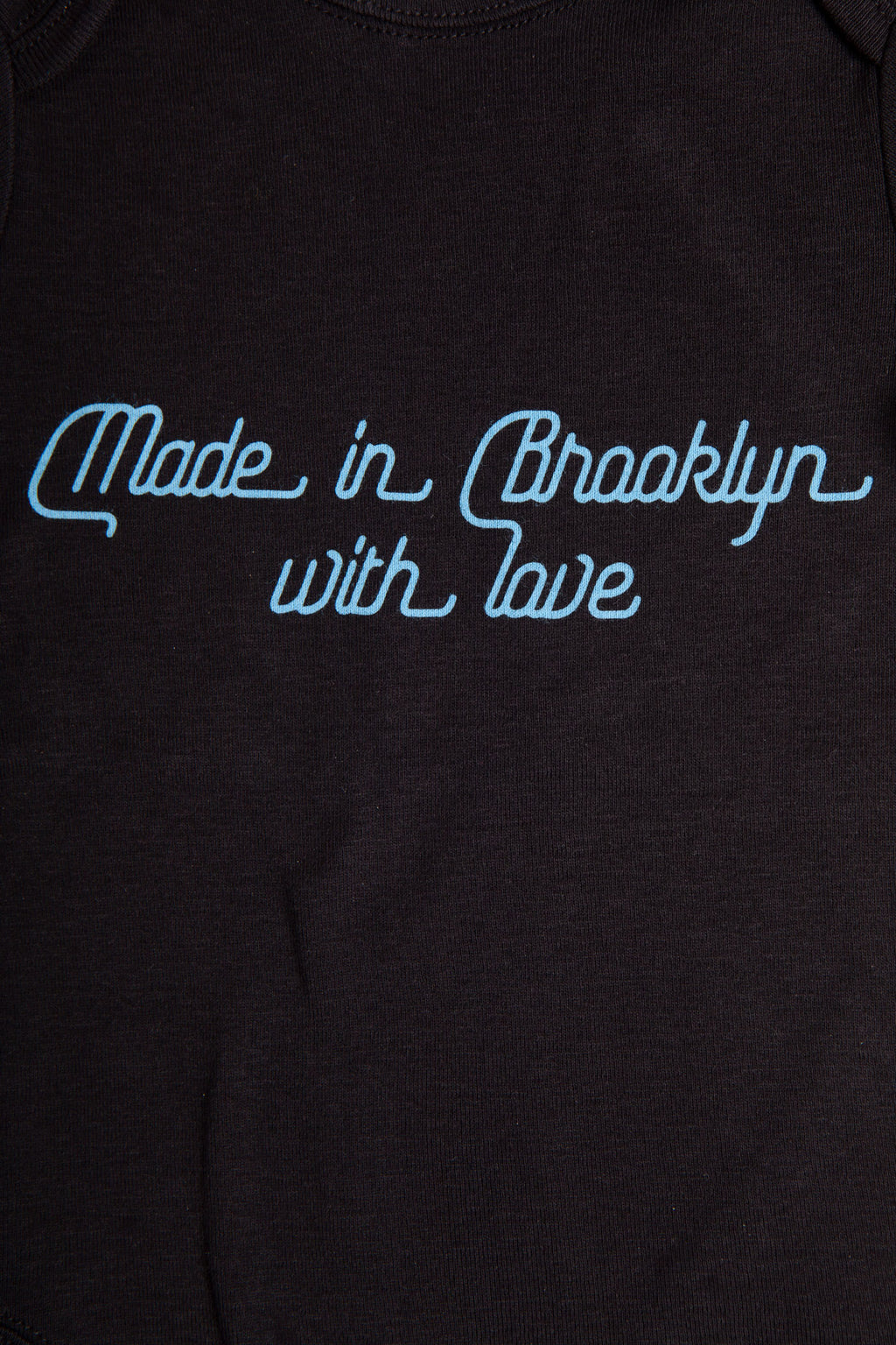 "Close up of script with the text ""Made in Brooklyn with love."""