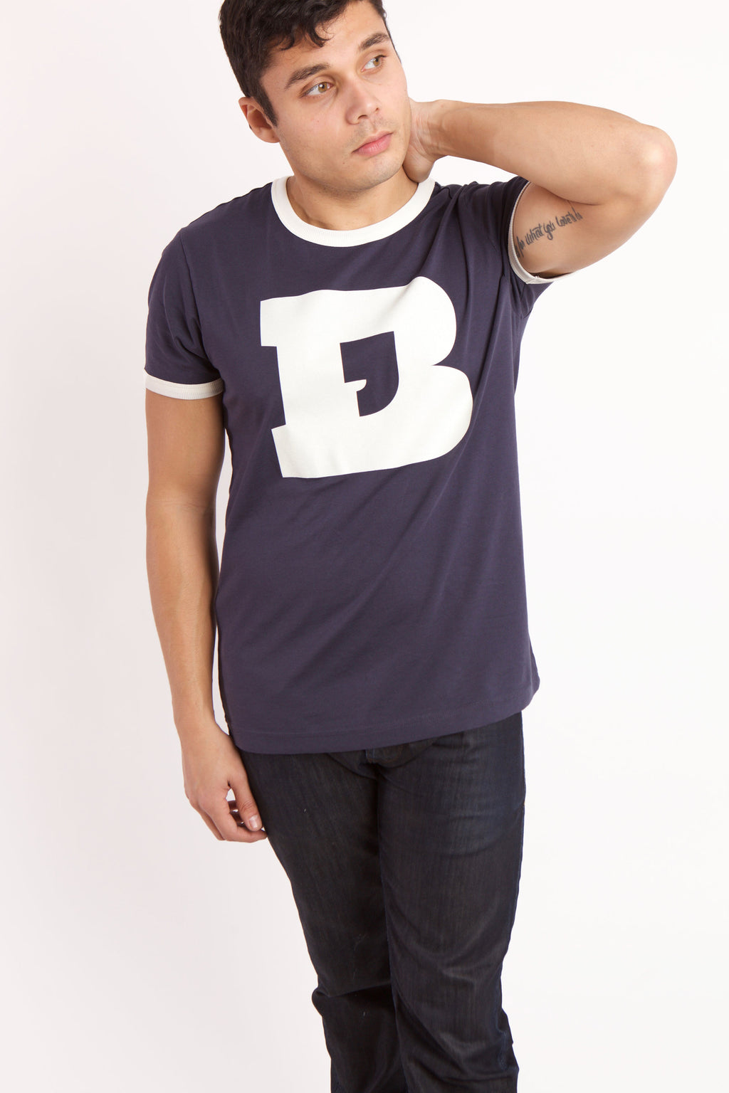 Comma B T-shirt on men's model with dark pants.  The model is holding up his left arm behind his head.