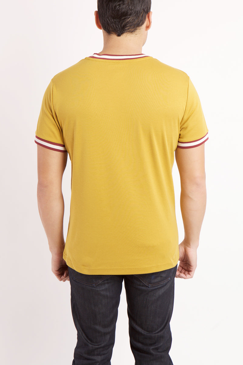 BACK VIEW OF  OF THE WHITE AND RED BROOKLYN TEXT ON YELLOW RADICAL RIBBED KNIT SHIRT WITH WHITE AND RED BANDING DETAIL ON SLEEVE AND COLLAR