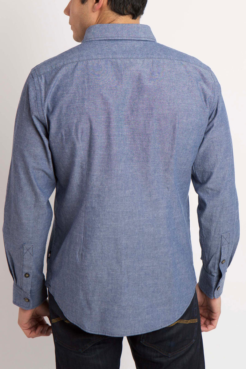 BACK VIEW , MAN WEARS BLUE BUTTON UP WOVEN SHIRT