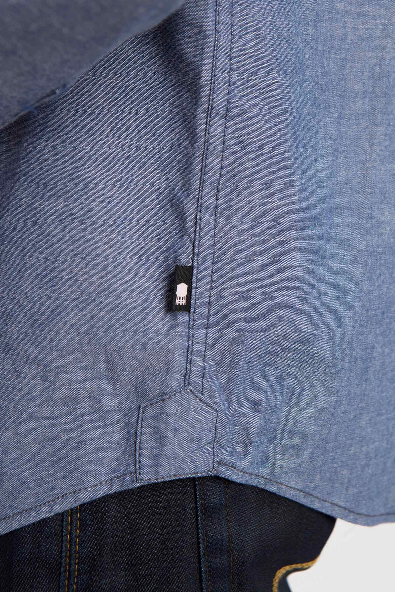WATER TOWER PATCH DETAIL ON BLUE WOVEN DURHAM SHIRT.