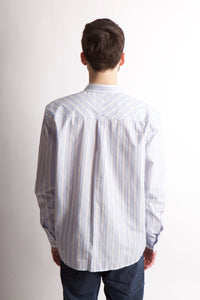 Back image of man wearing long sleeved men's woven shirt.
