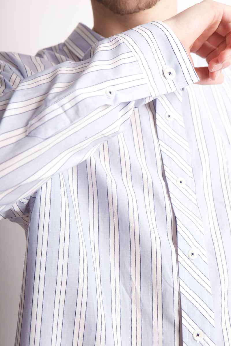 RIght cuff of blue and white striped shirt.