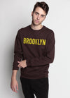 BROWN SWEATSHIRT WITH BROOKLYN IN YELLOW ACROSS THE CHEST