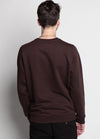 BACK OF BROWN SWEATSHIRT WITH BROOKLYN IN YELLOW ACROSS THE CHEST