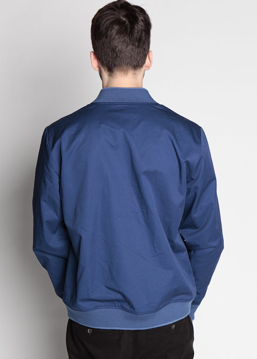 BACK VIEW OF HURON REVERSIBLE BOMBER COAT IN NAVY