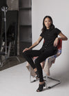 MODEL IN STUDIO IN BLACK MEAGAN PETER PAN TOP  SITTING IN CHAIR