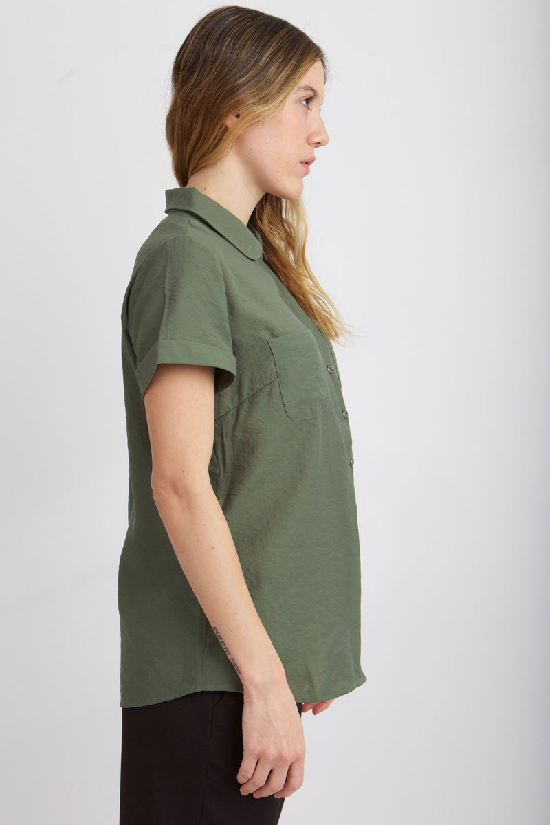 SIDE VIEW OF MODEL IN MEAGAN PETER PAN TOP  IN GREENER