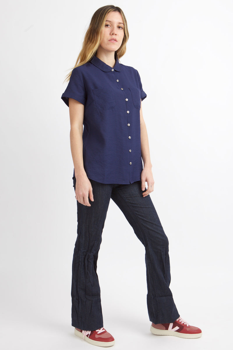 WOMEN STANDS TO SIDE WITH MOOD INDIGO MEAGAN BUTTON UP TOP