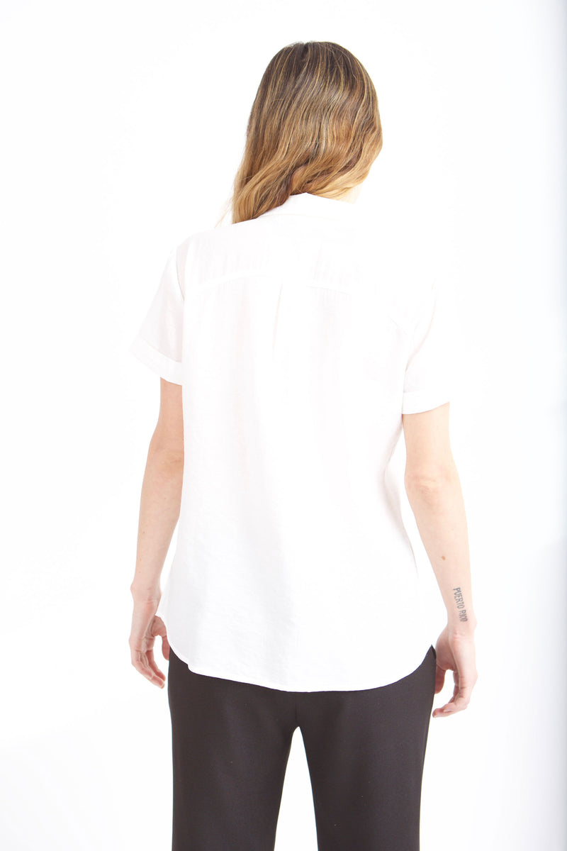 BACK VIEW OF PETER PAN SHIRT IN WHITE ON FEMALE MODEL