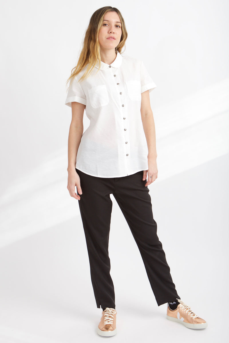 WOMEN WEARS BLACK PANTS AND WHITE MEAGAN PETER PAN TOP