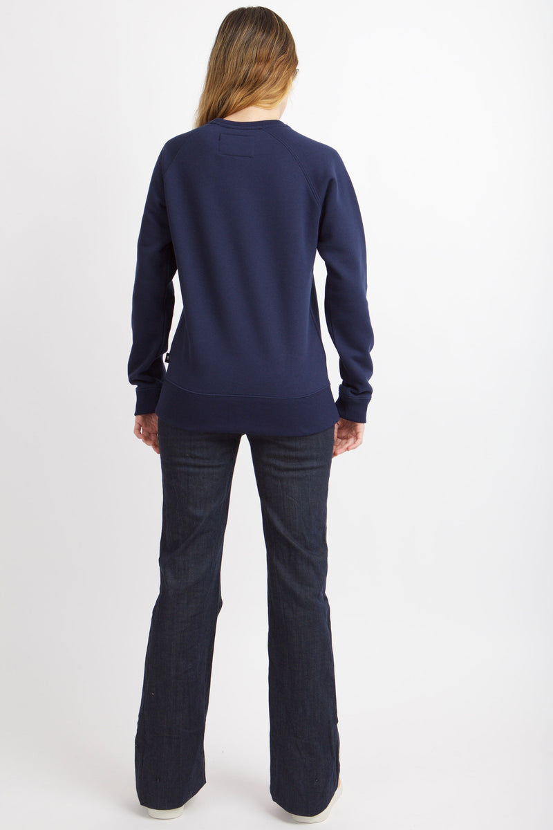 Back image of woman wearing navy applique sweatshirt