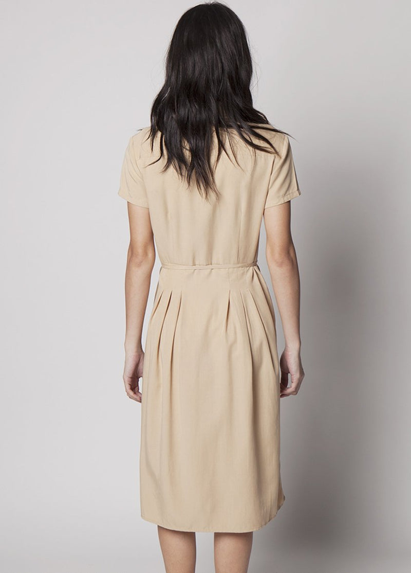 BACK VIEW OF MODEL IN KHAKI DRESS WITH BUTTONS AND DRAW STRING WAIST