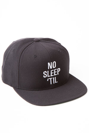 "Black baseball cap with embroidered white letters stating ""No Sleep 'Til."""
