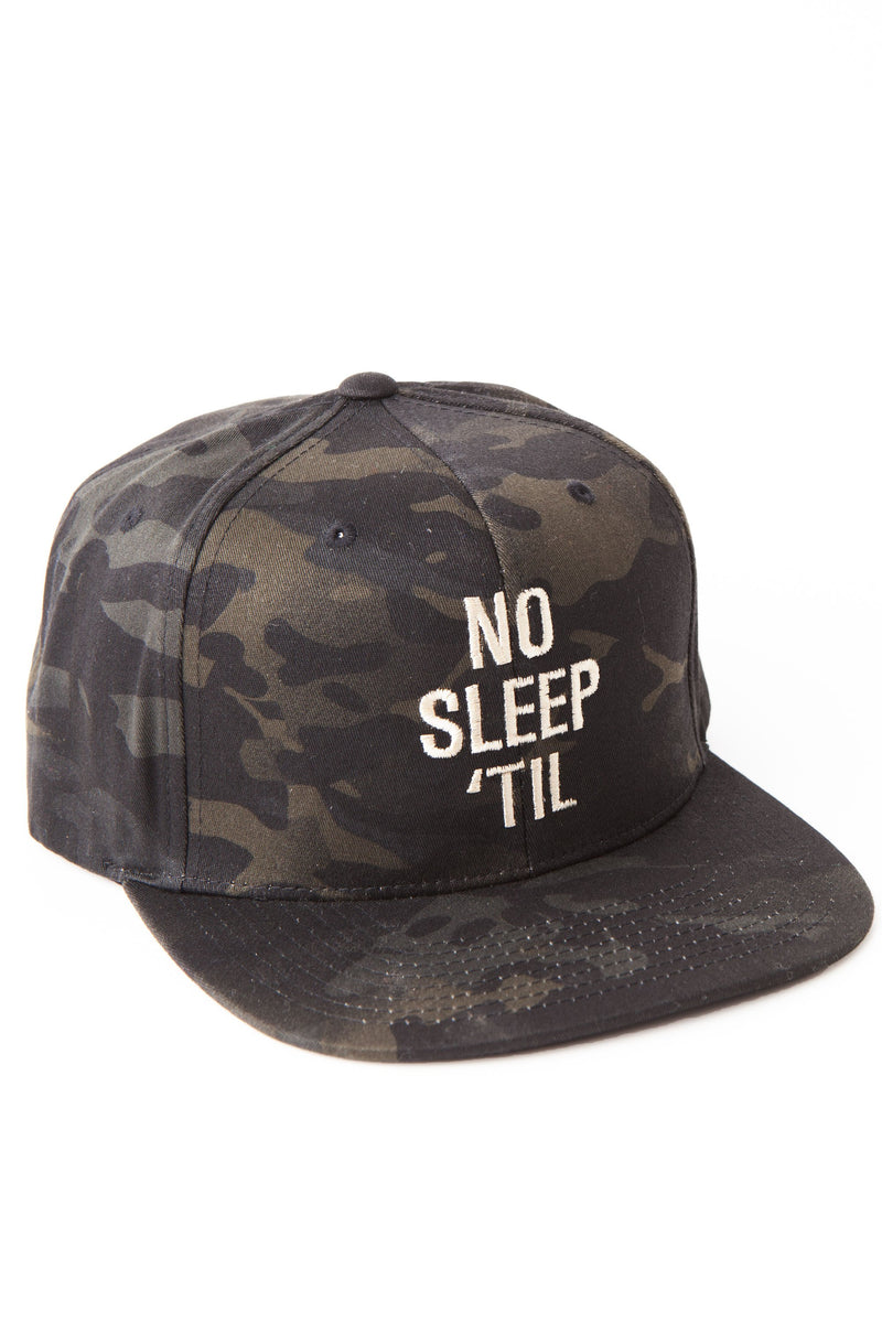 Camouflage baseball cap with white embroidered text No Sleep 'Til in vertical column on the front.