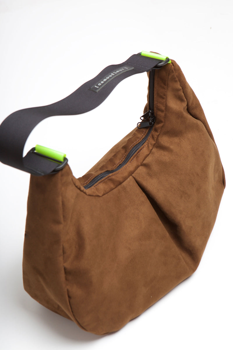 Overhead image of brown suede Viola bag.