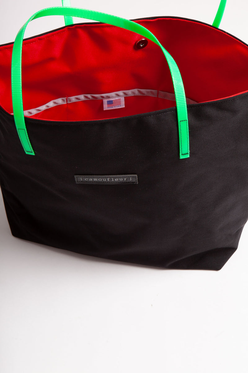 Side view of No 8 Camoufleur tote with lime green straps and red interior.