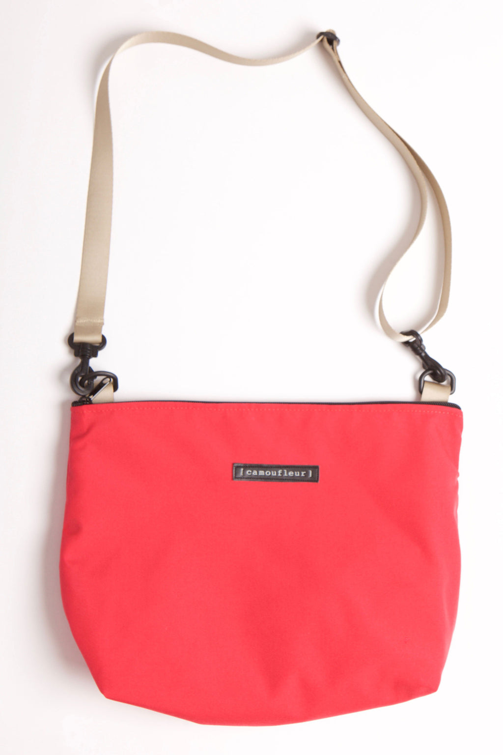 Red cross body nylon bag with khaki adjustable straps.