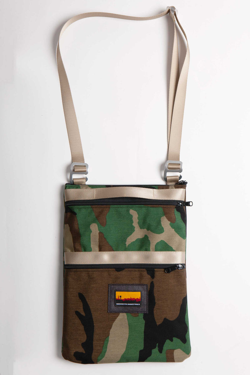 "FLAT LAY IMAGE OF 13"" LAPTOP BAG IN WOODLAND CAMO WITH KHAKI WEBBING"