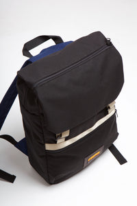 Top over backpack showing zipper on top flap of black mass backpack.