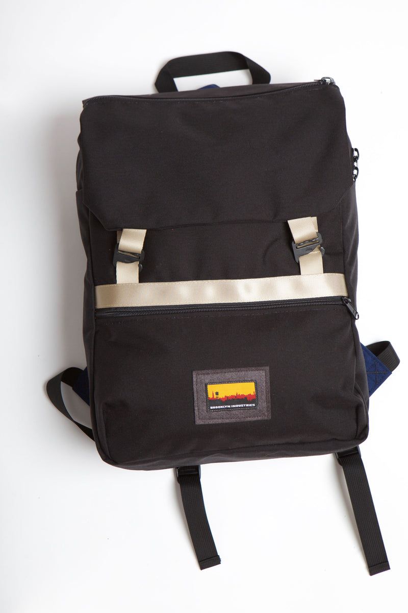 Black mass backpack with khaki trim and skyline logo