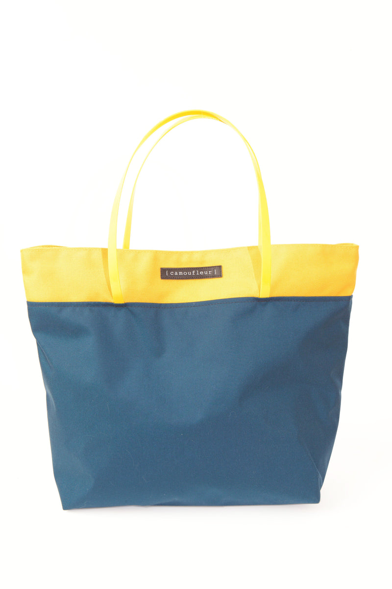 FRONT VIEW OF CAMOUFLEUR TOTE WITH INDUSTRIAL YELLOW HANDLES IN BLUE WITH YELLOW TRIM