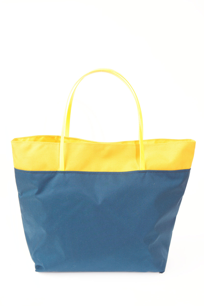 BACK VIEW OF NAVY AND YELLOW TOTE WITH MATCHING YELLOW HANDLES BY CAMOFLEUR