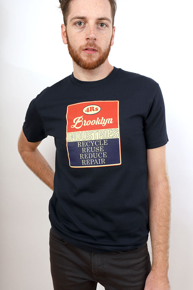 MAN WITH HAND ON HIP, WEARING BLUE 4R OF BROOKLYN VINTAGE PRINT T