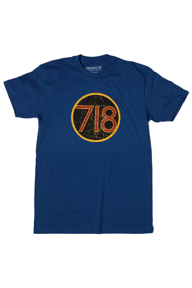 FLAT LAY BLUE T-SHIRT WITH 718 GRAPHIC IN A CIRCLE ON CHEST, YELLOW RED AND BLACK