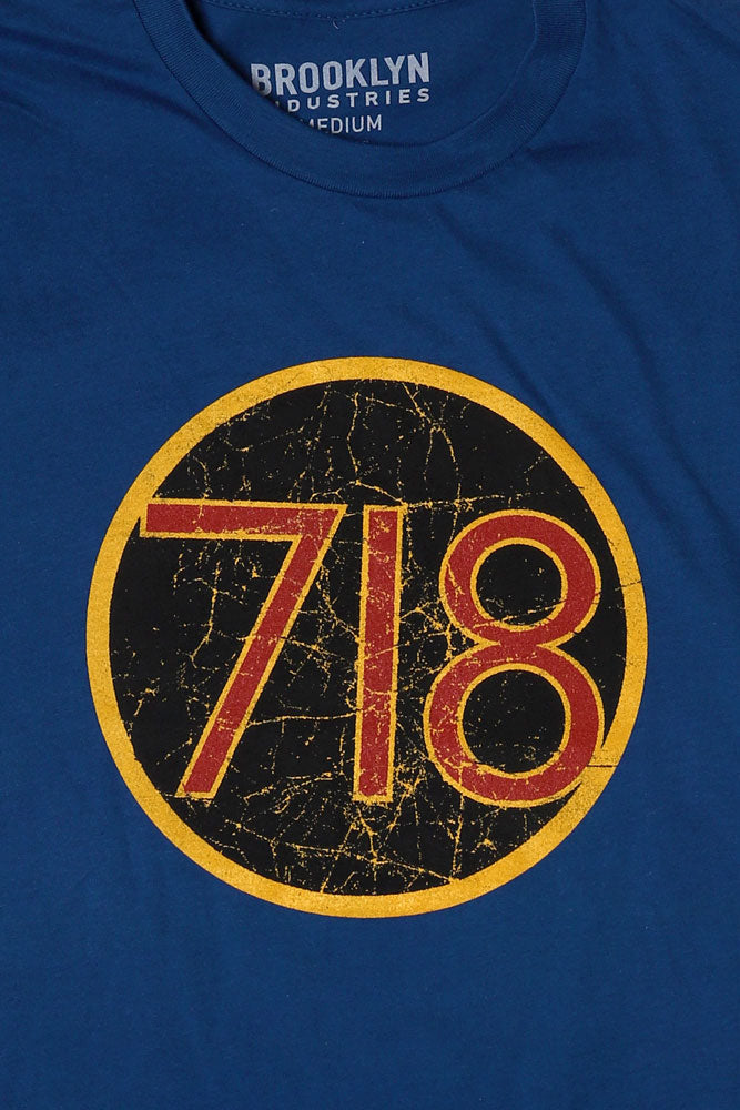 DETAIL OF 718 GRAPHIC IN A CIRCLE ON CHEST, YELLOW RED AND BLACK